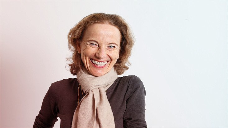 Smiling photo of Princess Dr. Gabrielle Oettingen of New York University (NYU) wearing a scarf and jacket.